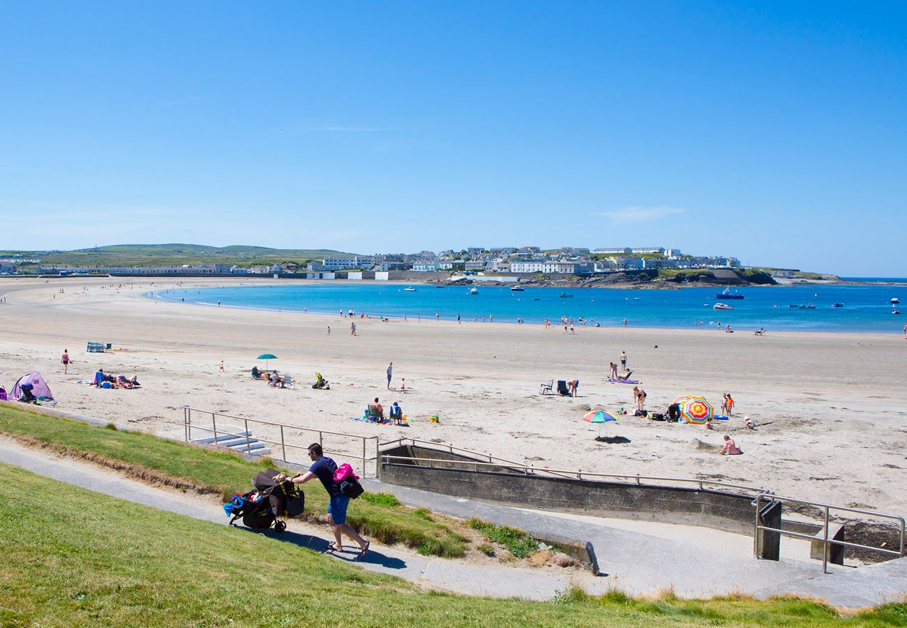 Kilkee golden sandy beach, sitting at the end of a sheltered bay in Clare, Ireland