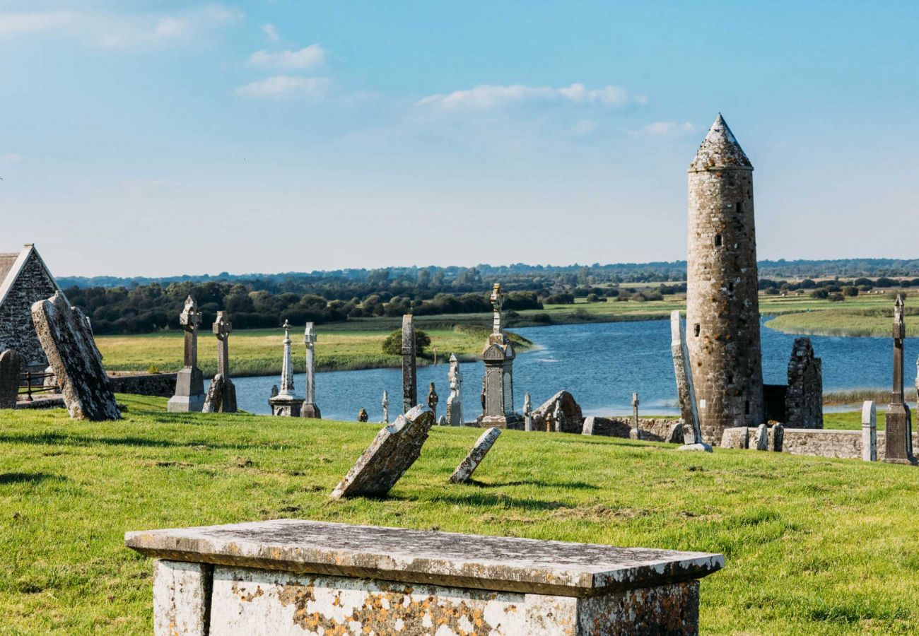 Clonmacnoise Graveyard and Round Tower, County Offaly © Failte Ireland
