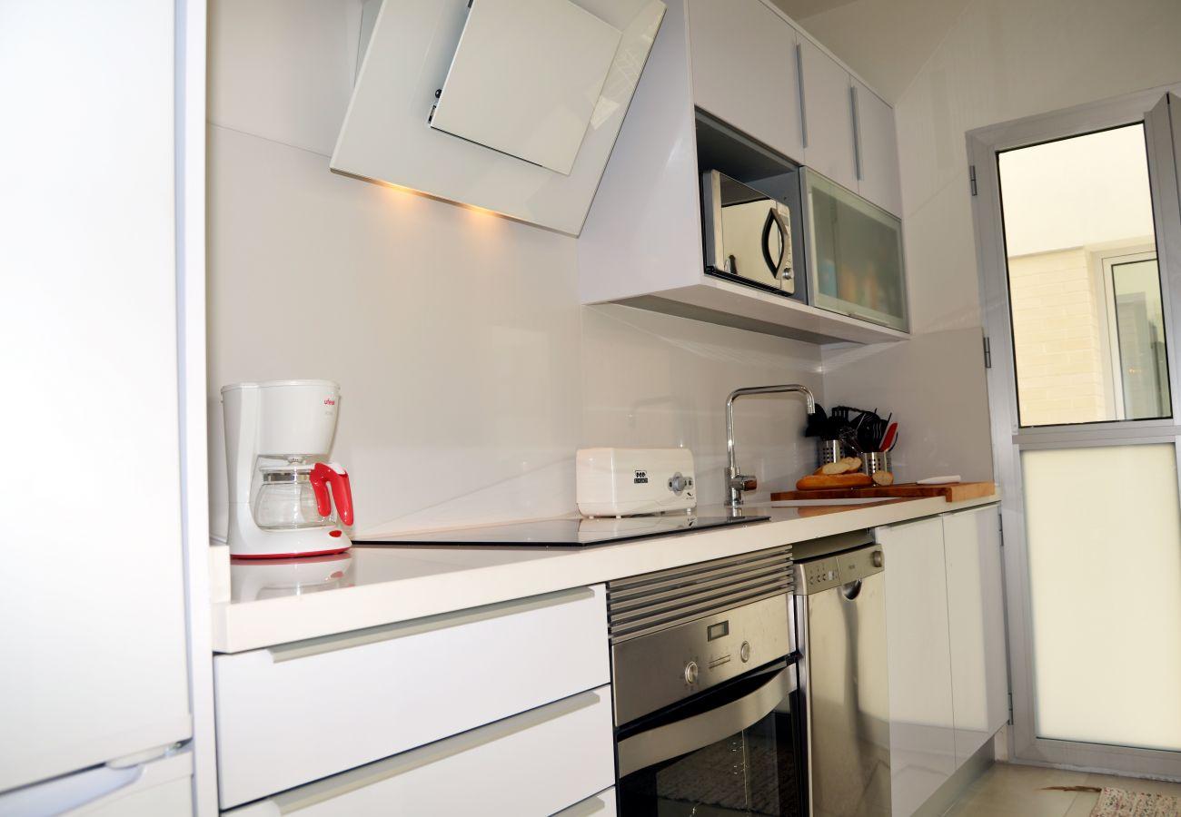Spacious and modern kitchen of Santiago de la Ribera apartment