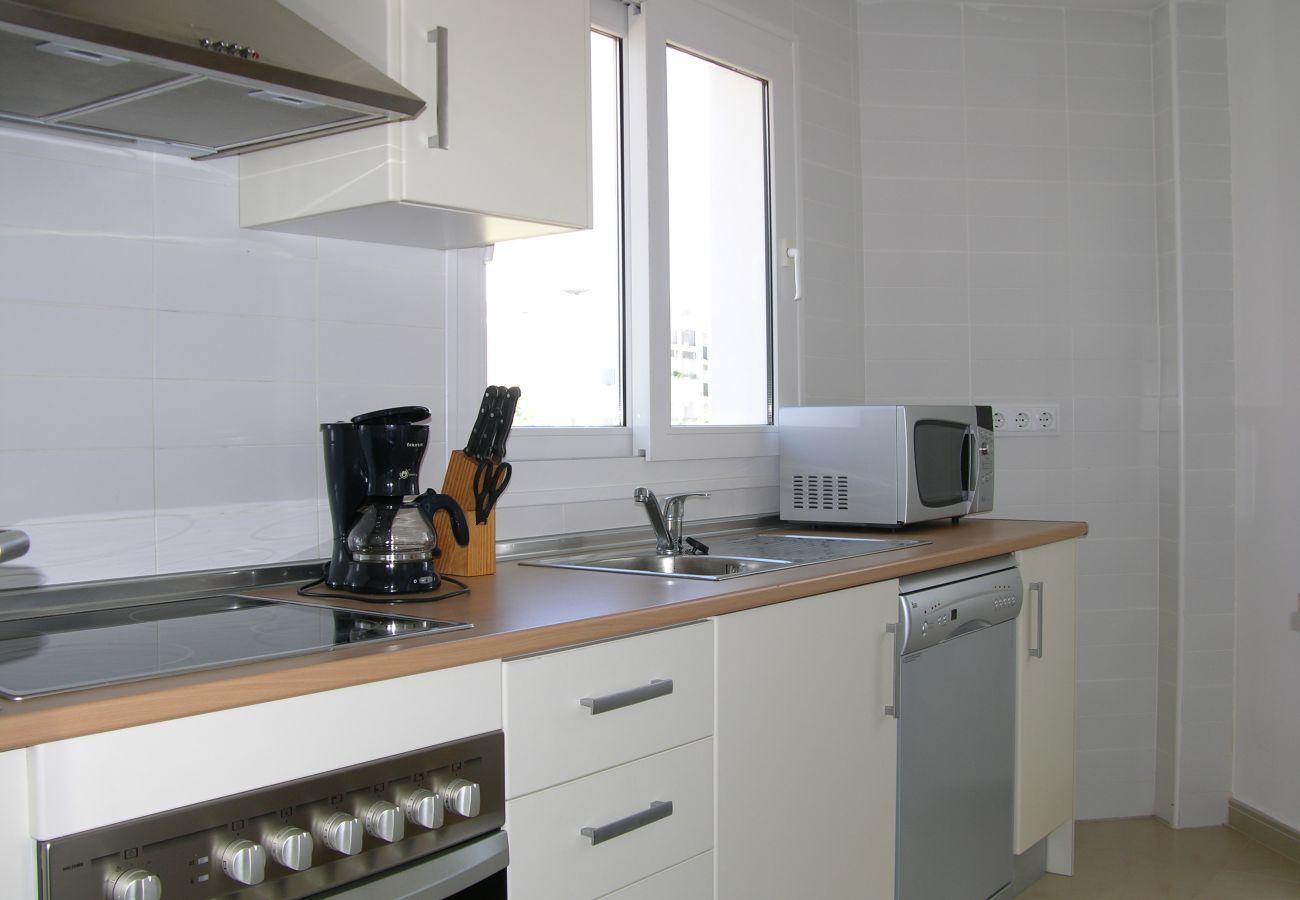 Beautiful and modern kitchen of Hacienda Riquelme apartment